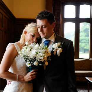 bride and groom up close in drawing room