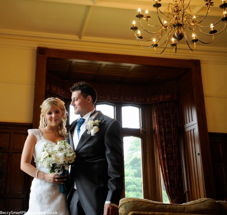 bride and groom posing in drawing room at st audries park