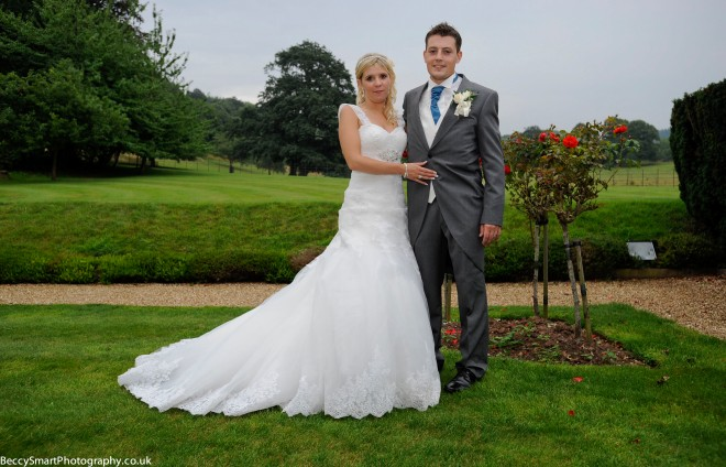 bride and groom in the rose garden