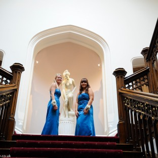 bridesmaids at the top of the stairs